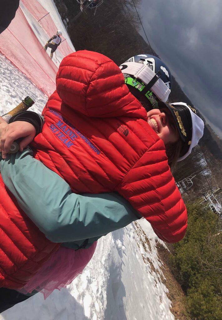 Two members of Lafayette ski club embrace in a hug