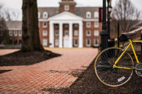 Watson Hall with a yellow bicycle