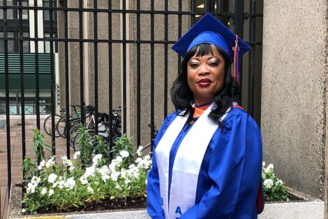 Princess Adeyinka '20's Mom in graduation cap and gown