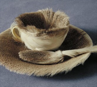 Maya Nylund '23 recreates Meret Oppenheim's Object, 1936, fur-covered cup saucer and spoon, Museum of Modern Art.