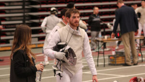 Andrew Mange '19 in fencing gear