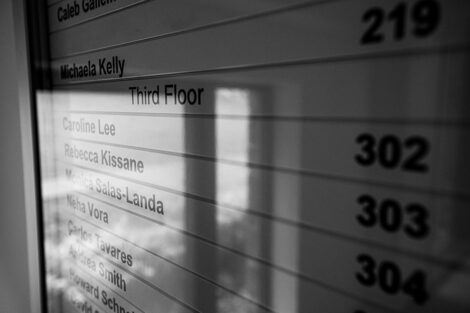 Names of professors on a sign inside of Oechsle Center for Global Education