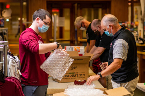 staff put items in boxes for Class of 2020 grads