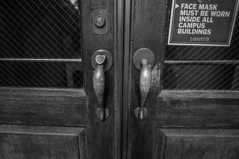 black and white image of a door of Pardee Hall
