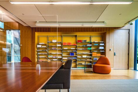 A bookshelf holds magazines in Skillman Library