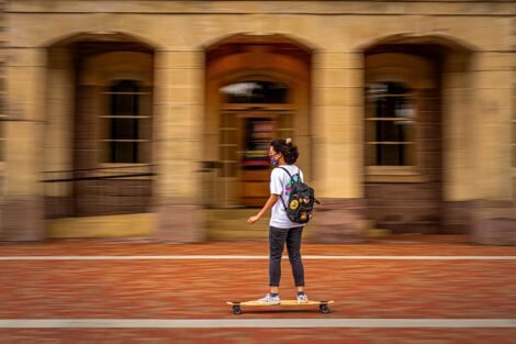 A student skateboards past Pardee
