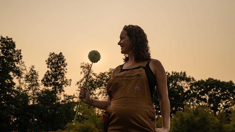 Jenn McAtee holding a flower