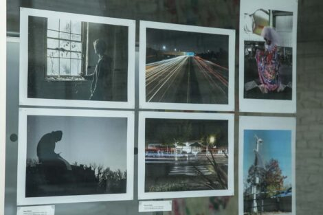 Images taken by student photographers on display in windows
