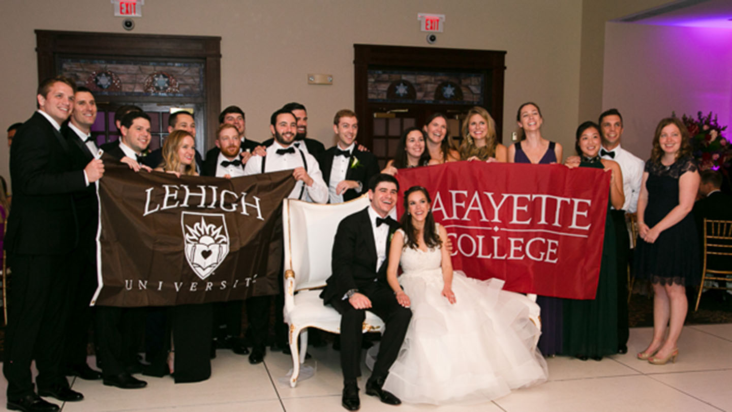 Guests at a wedding with Lafayette and Lehigh banners