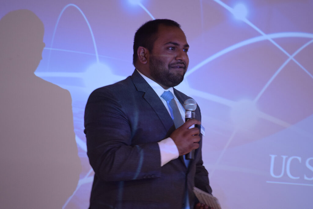 Tavreet Garg '10 speaks, holding a micrphone