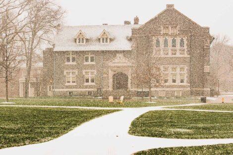 a light snow falls on Hogg Hall