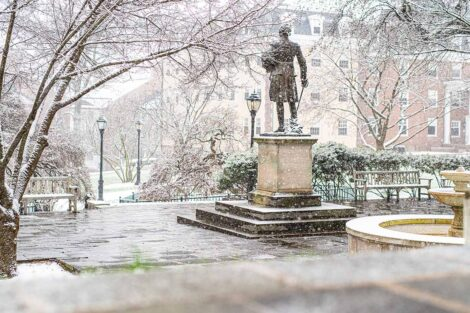 statue of Marquis de Lafayette by Colton Chapel with snowfall
