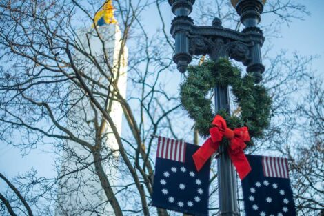 a green wreath with a red bow hangs in downtown Easton for the holidays