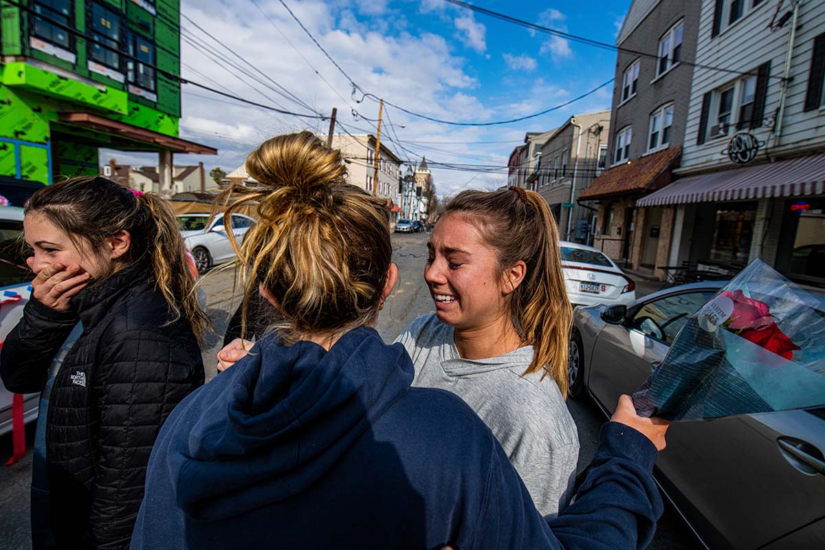 Students embrace on a street near Lafayette's campus