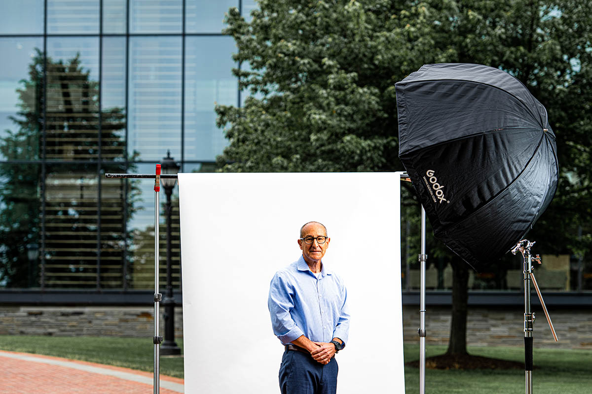 Dr. Jeff Goldstein in front of a white screen, set up in front of Skillman library