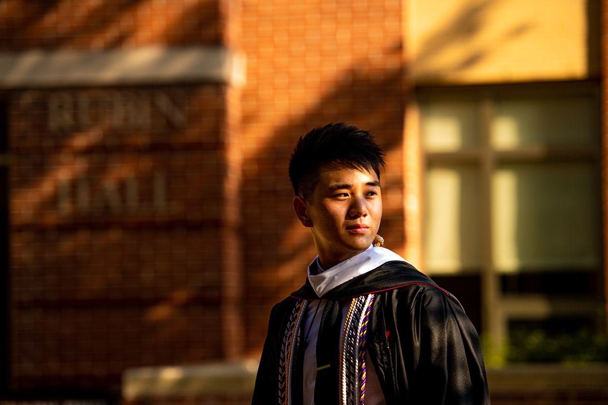 Randy Zhou '20 in graduation cap and gow n