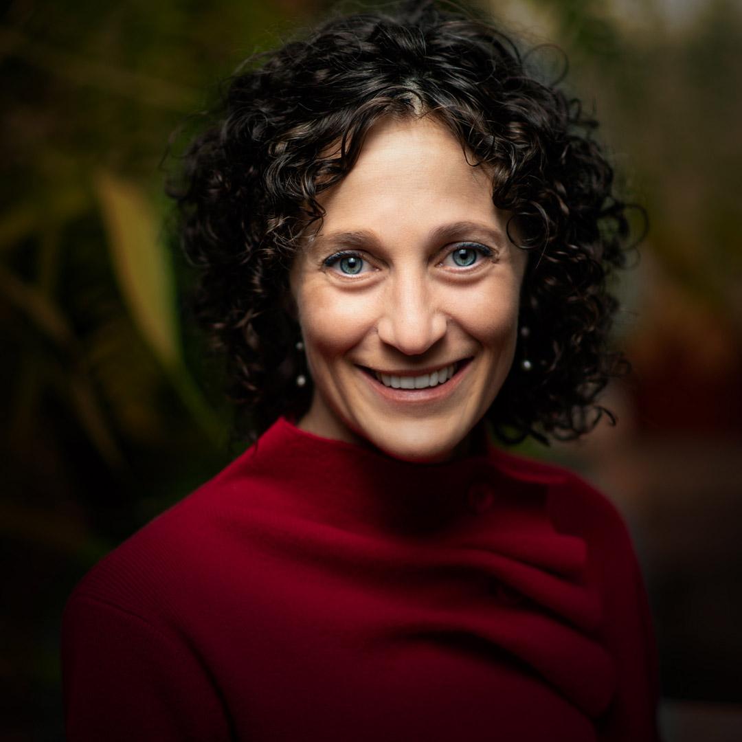 Delicia Nahman, director of sustainability, smiles