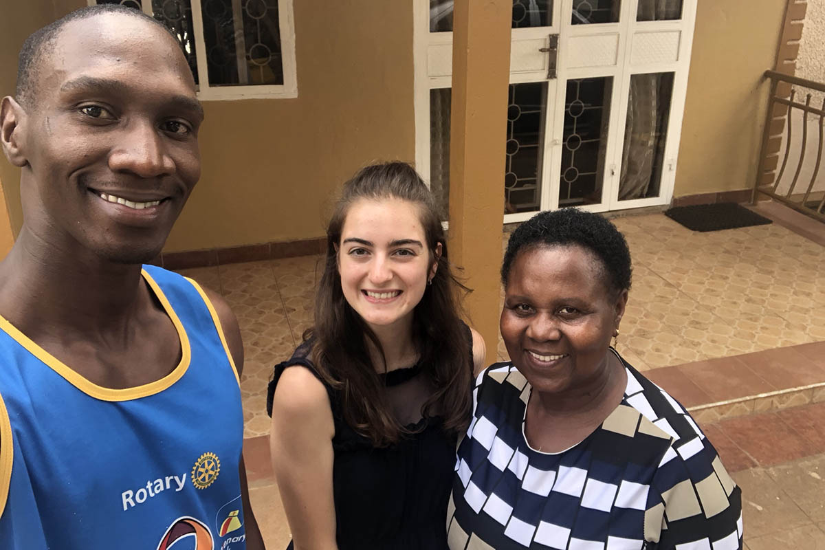 Victoria Puglia '21 smiles in a selfie with her host family in Uganda