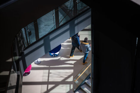 Two students walk down a hallway of Rockwell Integrated Sciences Center