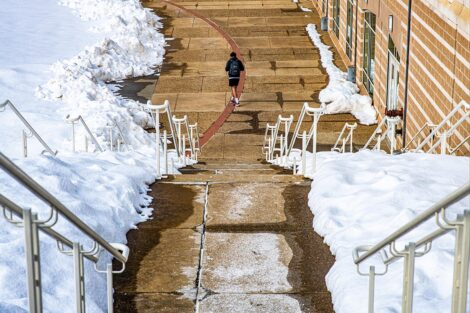 A student walks down the steps leading to Kirby Sports Center