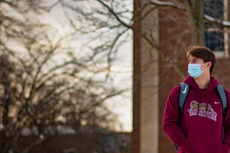 A masked student in a Lafayette sweatshirt