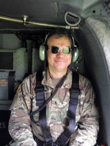 David Komar in military gear
