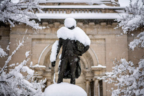 A statue of the Marquis de Lafayette, covered in snow
