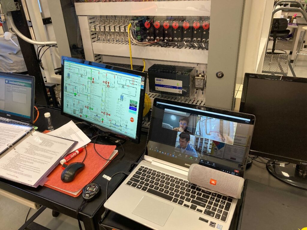 Alex Qian '22 (upper Zoom box) and Ziyang Guan '21 participate in hybrid chemical engineering lab