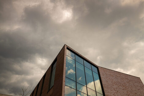 Grey storm clouds and Rockwell Integrated Sciences Center
