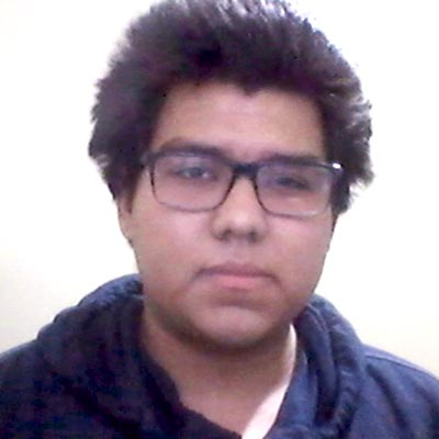 Grainy headshot of student in glasses and sweatshirt captured over Zoom