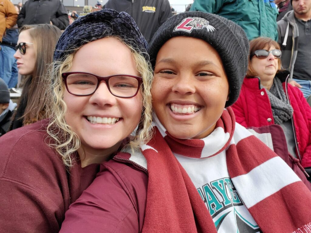 Ellie Aaberg '21 and Olivia Barney '21 at a Lafayette football game