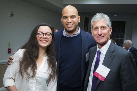 Image from scholarship dinner shows Rabia on the left, Yusuf Dahl in the center, and alumnus JB Reilly on the left