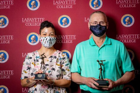Alana Danois and Michael Conover holding Aaron O. Hoff Award and standing in front of Lafayette College backdrop