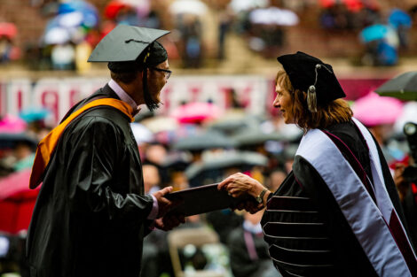 Alison Byerly hands diploma to senior Commencement 2021