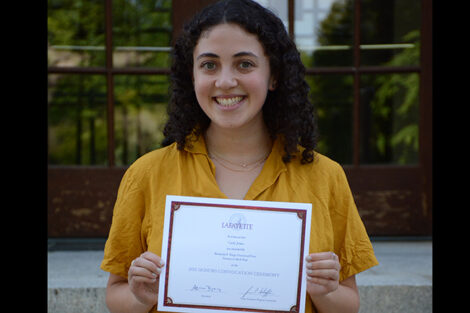 Carly Jones holds certificate