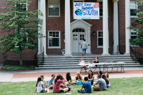students sit together in front of South Hall
