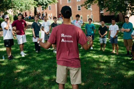 an orientation leader talks with a group of students