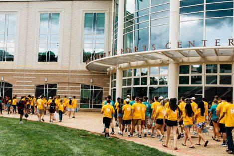 class of 2021 walks into Kirby Sports Center
