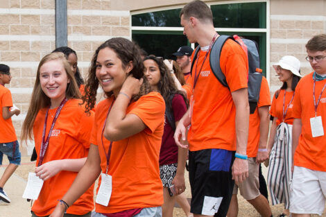 Class of 2021 students walk, talk, smile outside Kirby Sports Center