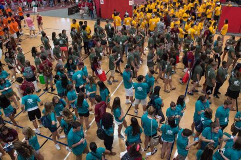 class of 2021 in 4 different colored shirt gather inside Kirby Sports Center
