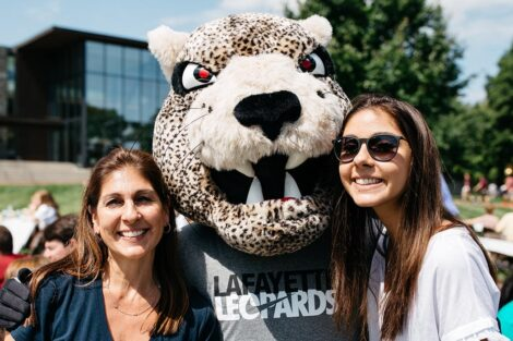 smiling student and parent on the Quad with the Leopard