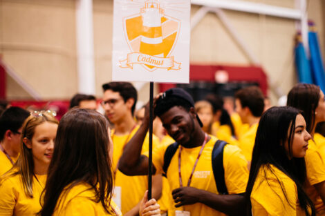 Students in matching yellow tshirts talk