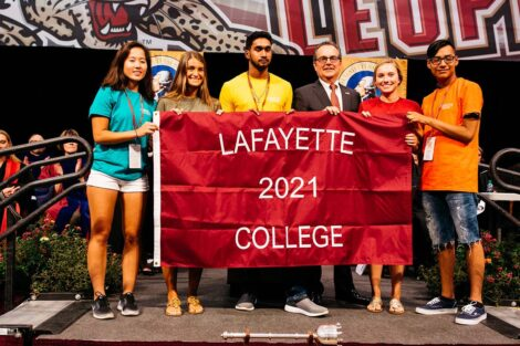 Students hold a Lafayette 2021 College flag.