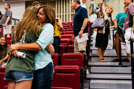 A student embraces their loved one.