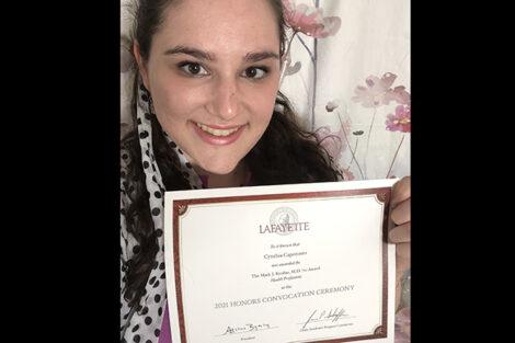 Cynthia Capotosto hold certificate