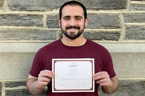 Devin Rosmarin holds certificate