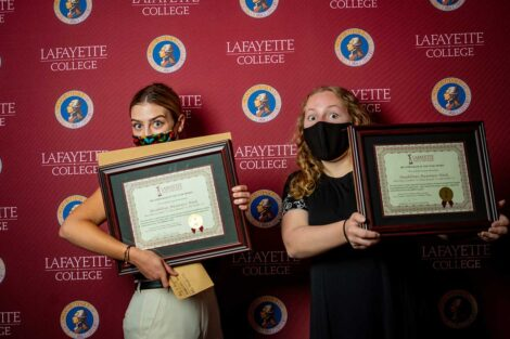 Student representatives of Disabilities Awareness Week holding Aaron O. Hoff Awards and standing in front of Lafayette College backdrop