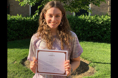 Genevieve Craig holds certificate