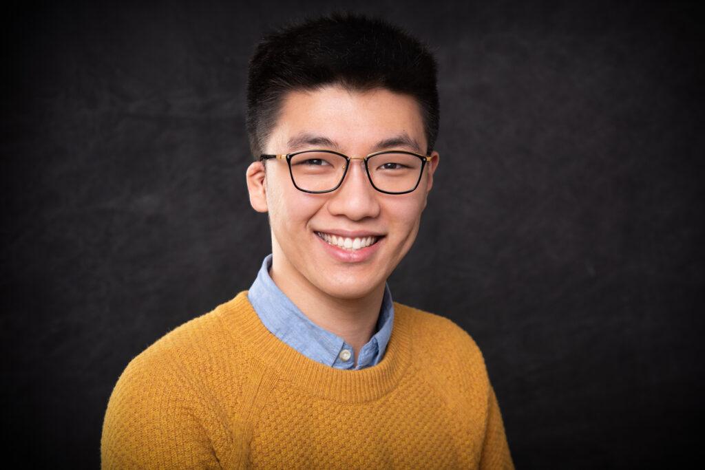 Dominic Zhang '21 posing for a head shot