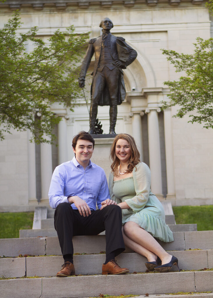 Dennis White '21 and Sarah Johnson '21 pose near the Marquis de Lafayette statue